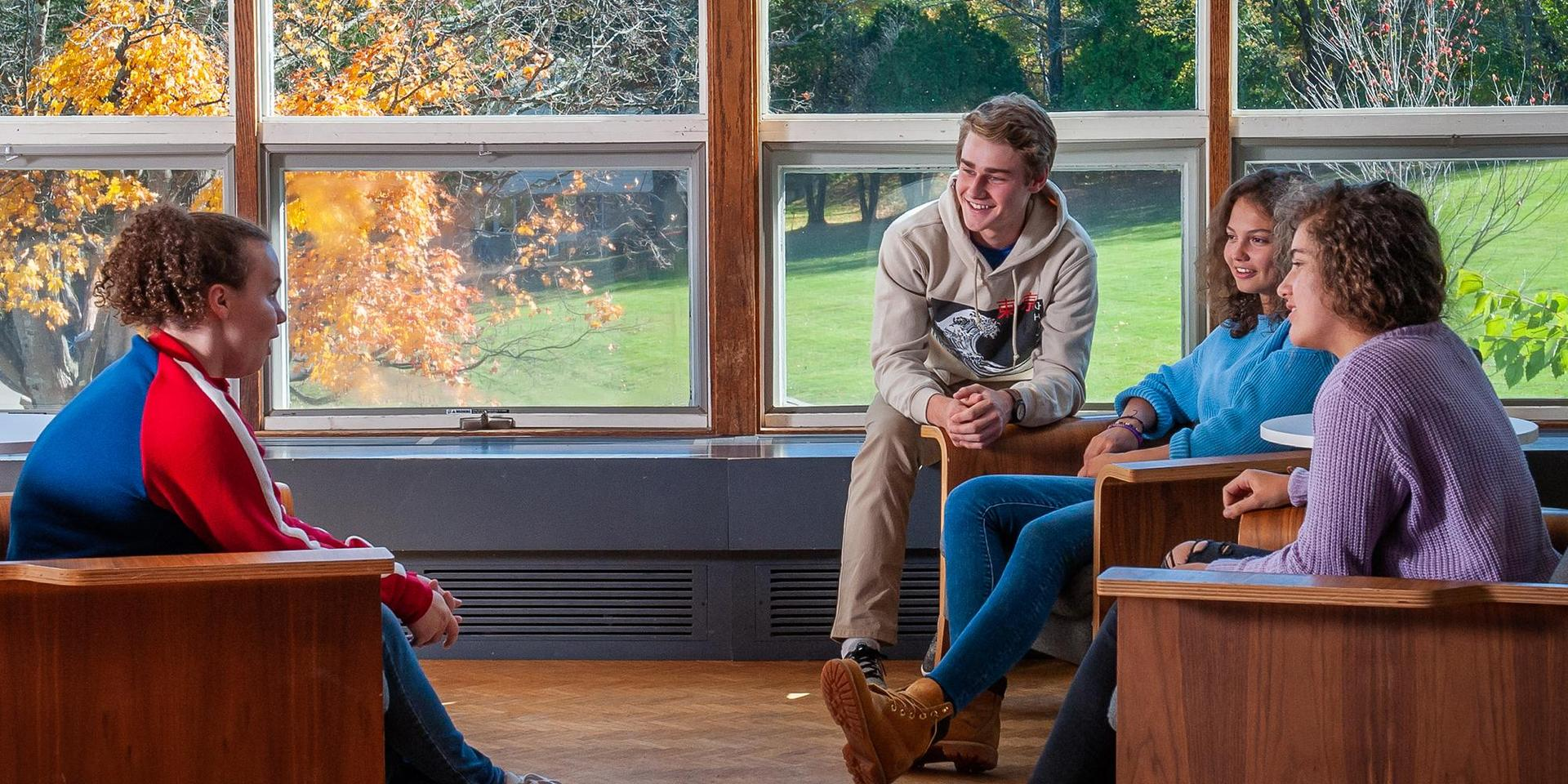 A group of students chatting on the second floor of the Main Building.