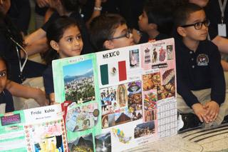 children presenting their posters