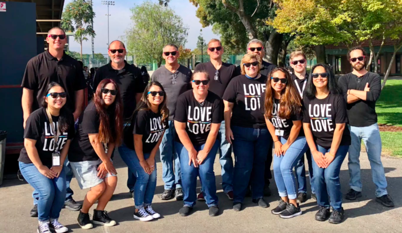 A picture of all the teachers wearing their black Love Means Love shirts.