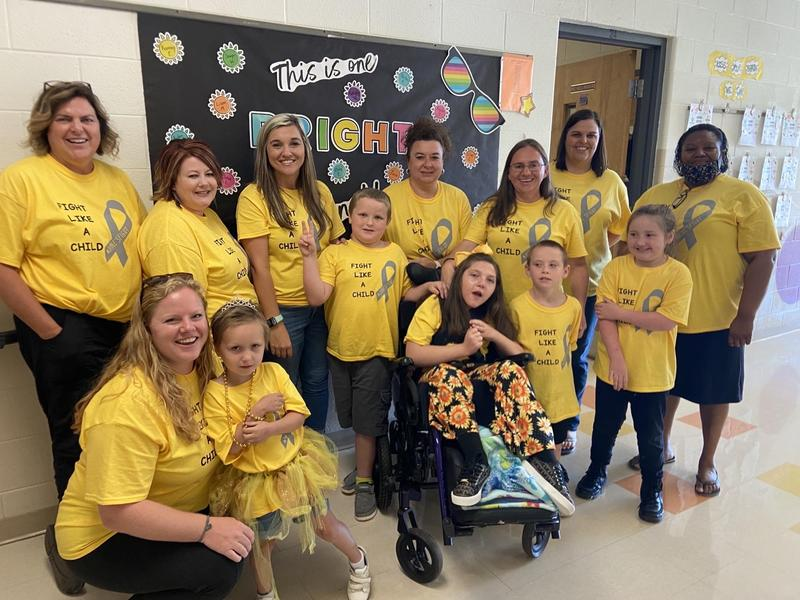 Picture of some TPES staff and students wearing gold and yellow in support of Childhood Cancer Awareness Month.