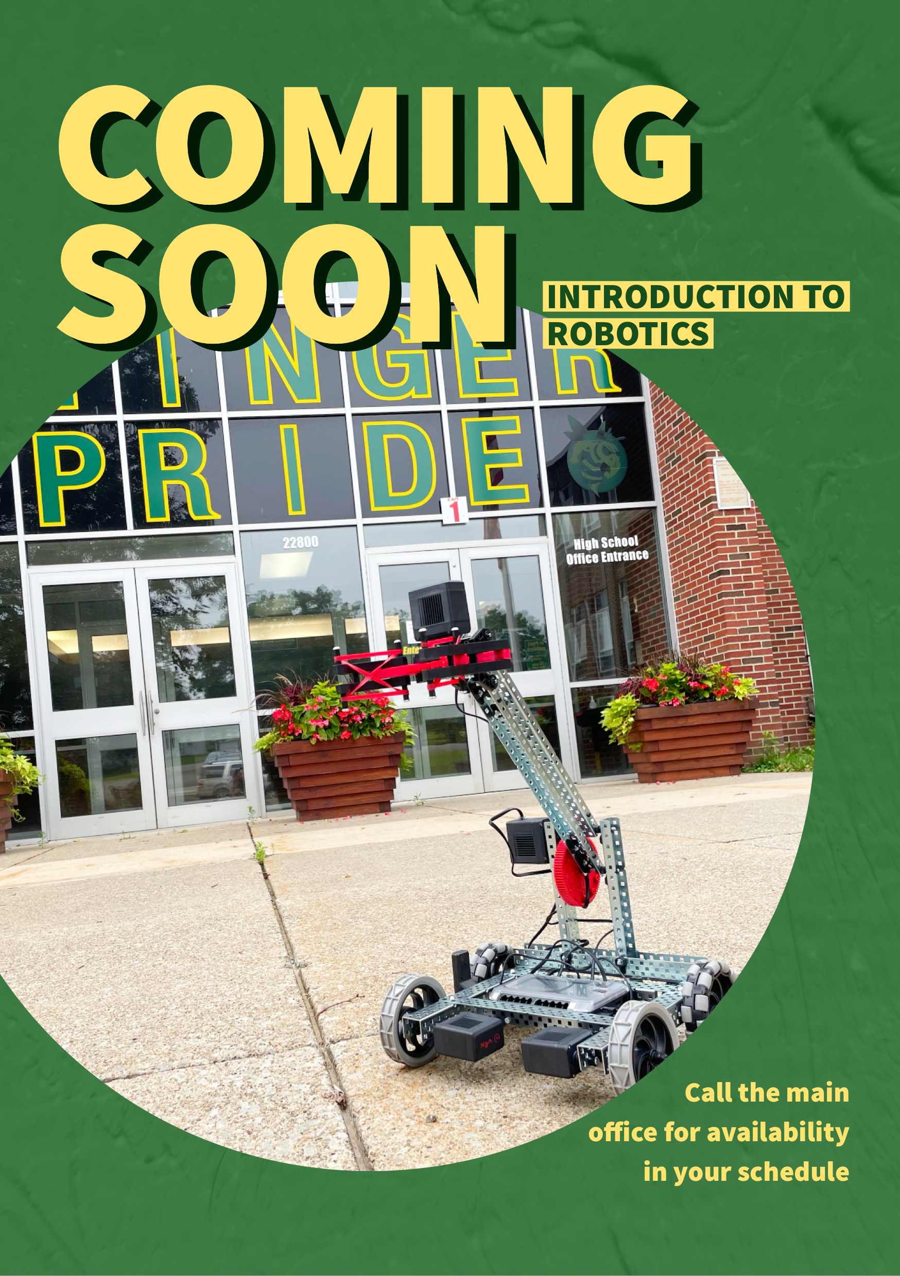 Coming Soon: Introduction to Robotics.  a Vex claw-bot drives in front of the school main entrance.
