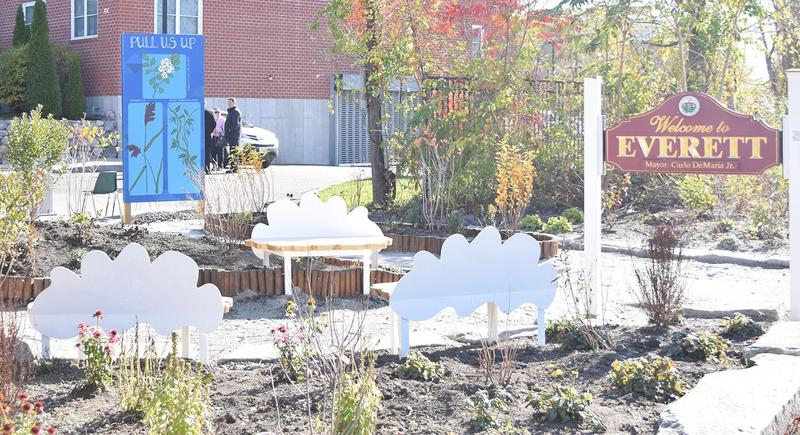 A wide angle view of the rain garden with the 'Welcome to Everett' sign in the foreground