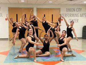 Dance troop in creative movement poses