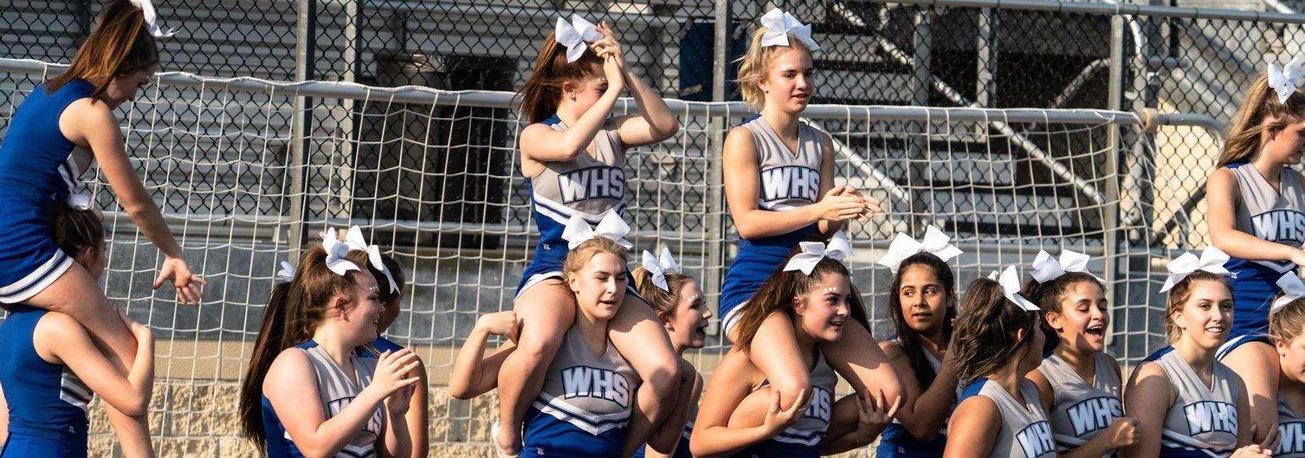 Freshman cheerleaders at a football game