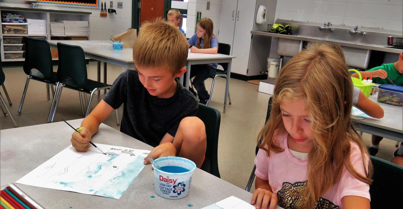 Students learn to paint water colors in Lee art.