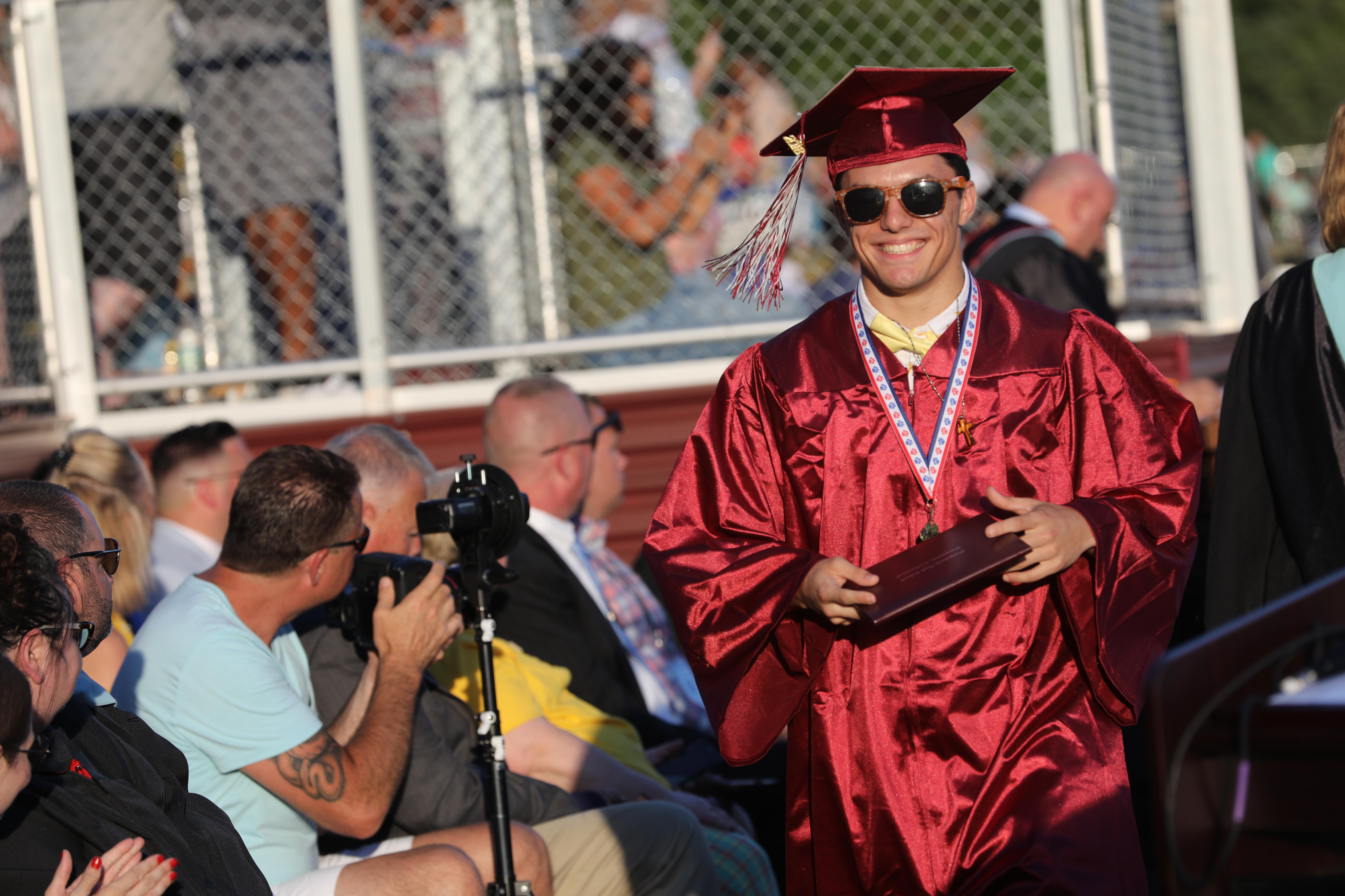 Student walking across stage at graduation