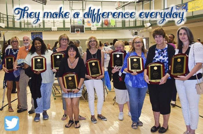 "10 of the 30 year award staff with the words above ""They Make a Difference Everyday"""