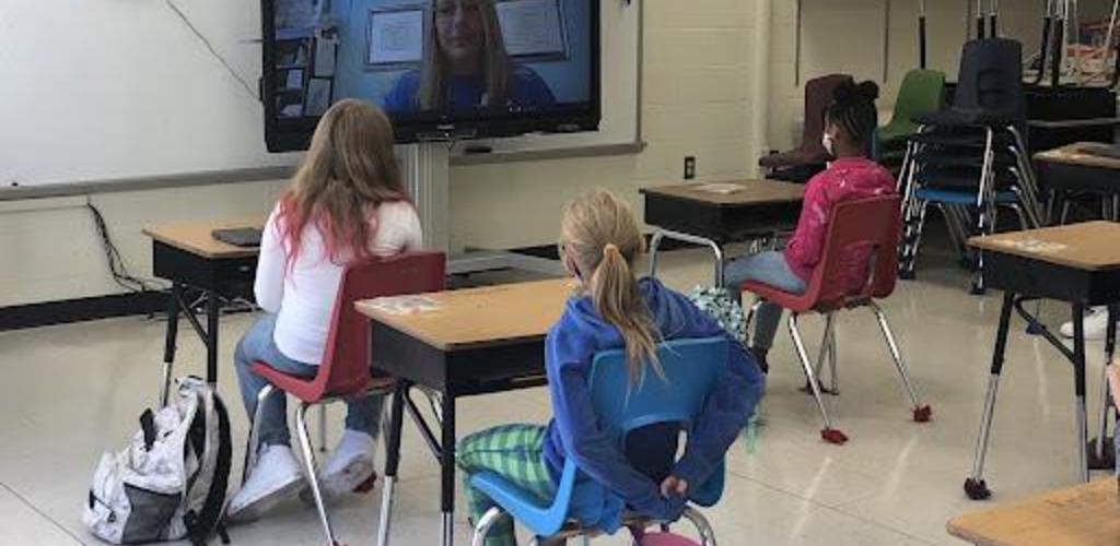 Students watching an online meet