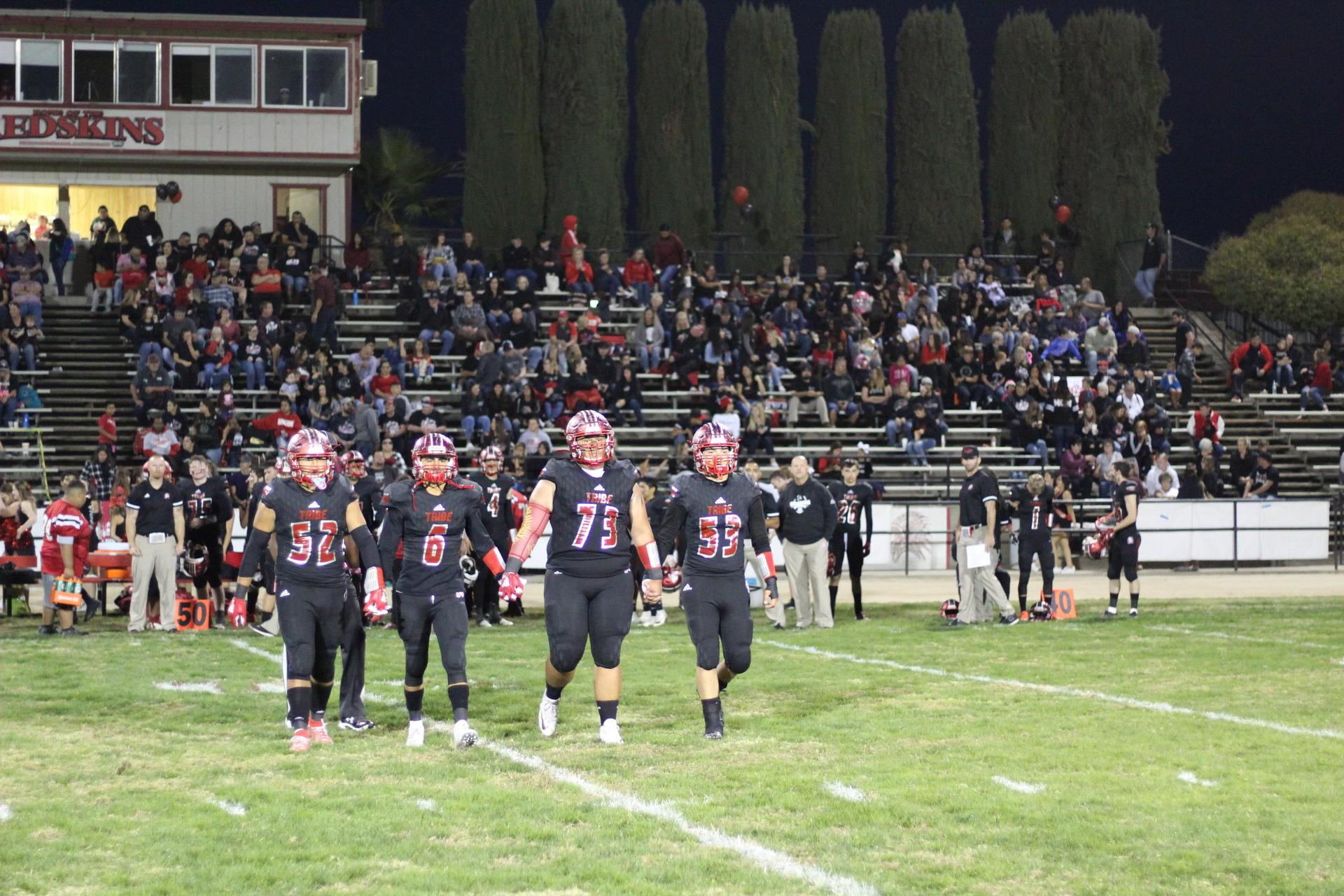 Tribe Varsity Football Players Walking to the Coin Toss