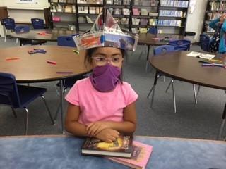 Girl in newspaper hat