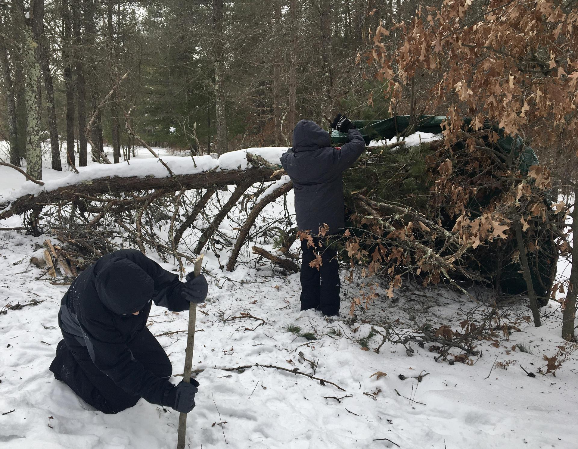 Students making a winter shelter