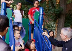 Fr. Gonzalez Speaking to Children 2019.jpeg