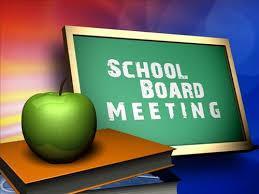 apple next to chalkboard with school board meeting written on it