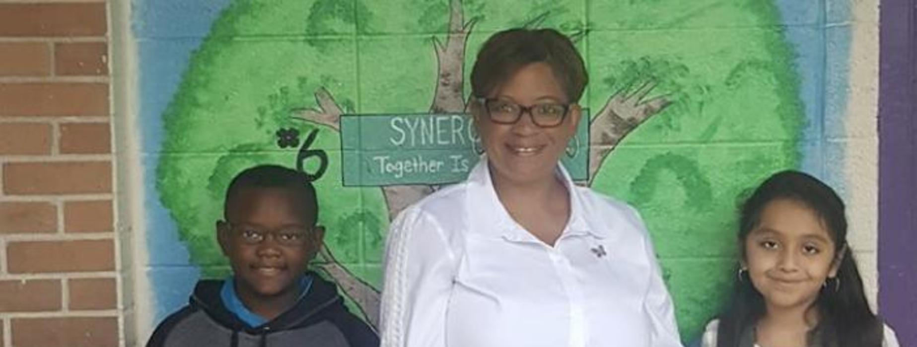 Mrs. Charles, principal, and her little principal's of the day. Pictured:  Kylon and Zoe