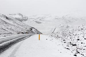 Image of a snowy mountain road