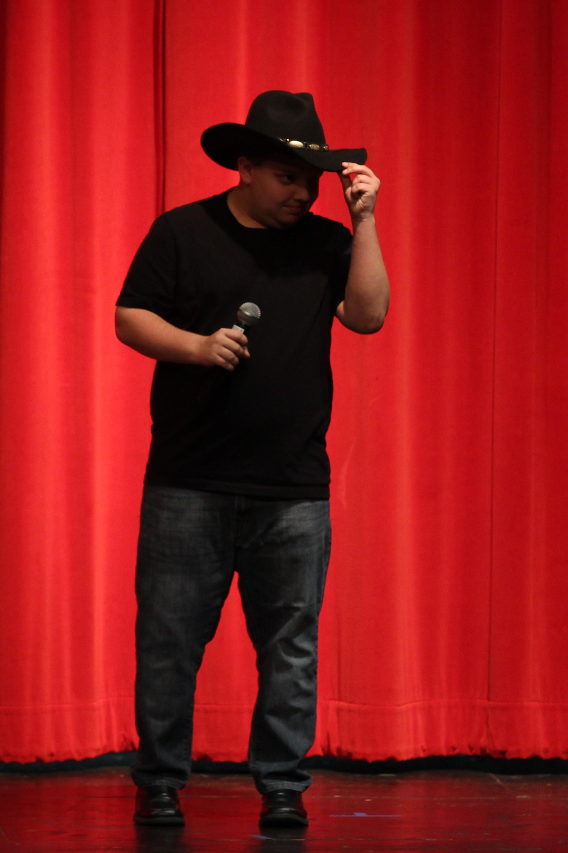 Jaxon Powell singing at the Talent Show