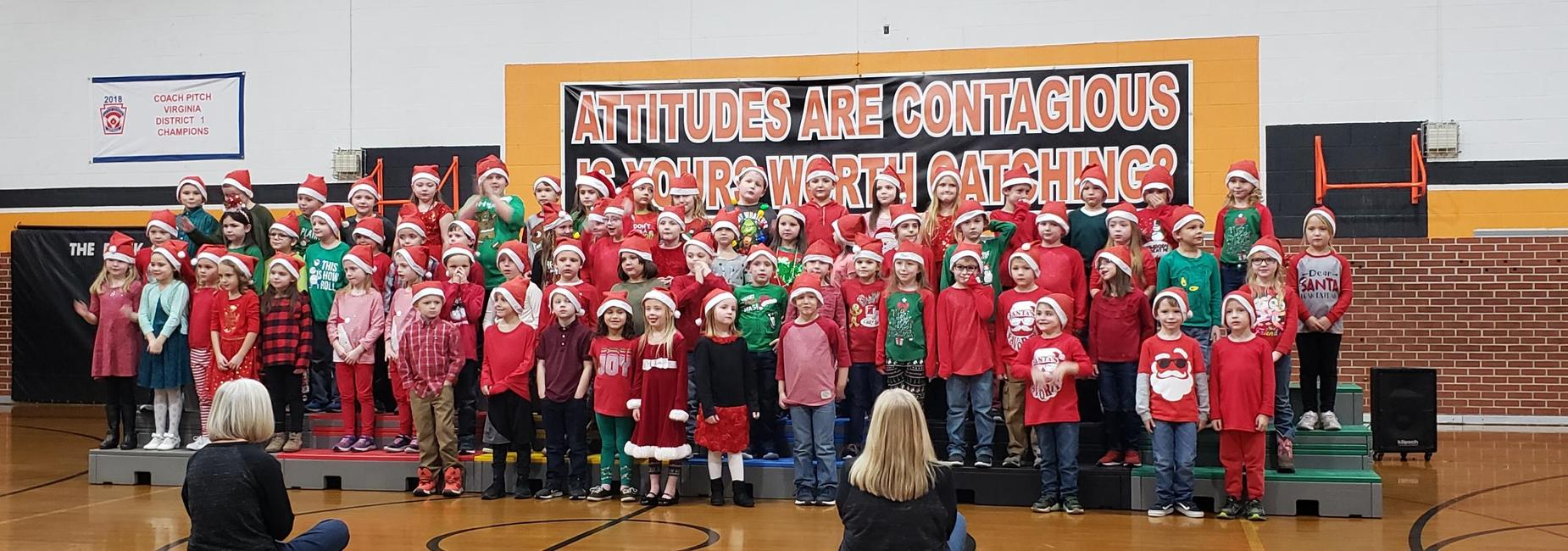 First Grade students singing for families on