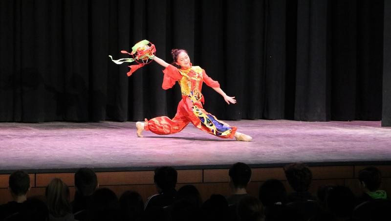 Dancer in colorful costume performs as Dance China New York (DCNY) took Roosevelt students on a tour of the culture, customs, language and dance heritage of China during a recent assembly.