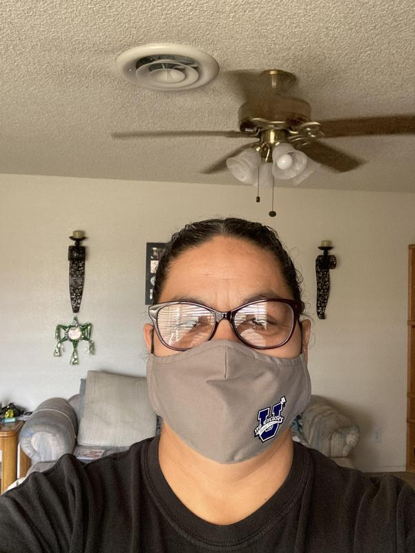 Maria Flores showing off her No Excuse University mask
