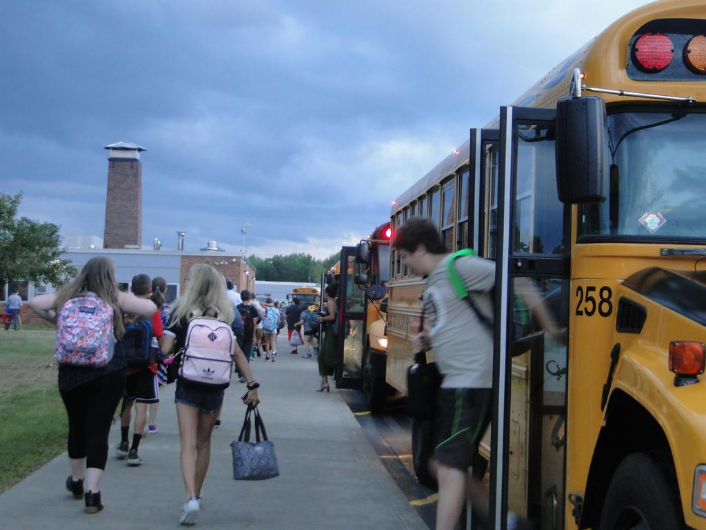 First day of school September 6, 2018 is also the first official use of the newly re-constructed bus loop. Pictured here are students exiting school buses for the start of classes.