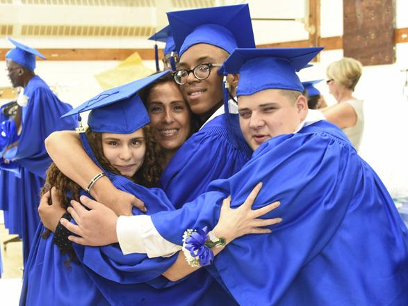 Three Schermerhorn graduates (Harris, Cruz and Sarai) with Nina hugging