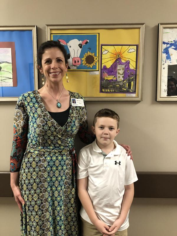 Decland Hill and Mrs. Mulkey at art display at Novant Health Center.