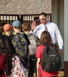 First Day LV Nate Lambdin high fives students#1√.jpg