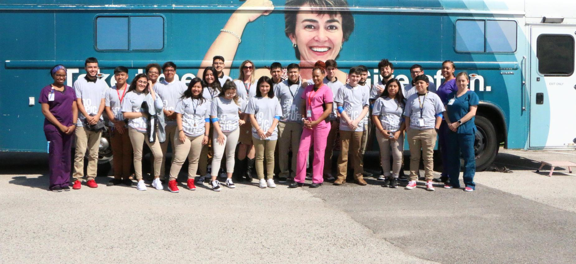 high school students and Carter blood drive bus