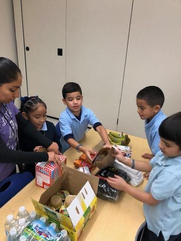 Second grade packed lunches for the homeless. Thank you to Ms. Fink for leading this activity!