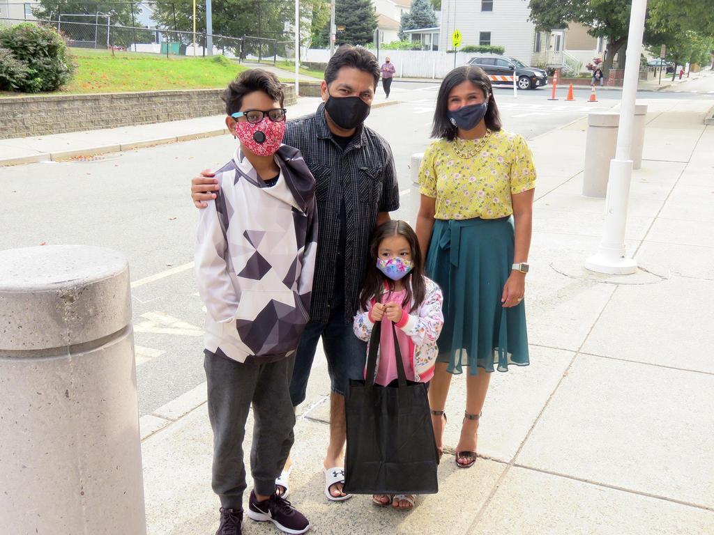 Superintendent Priya Tahiliani and a family