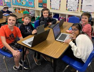 """Franklin students enjoy """"Hour of Code"""" activities during Computer Science Education Week.  On left, 5th grader Adam Siegel, 1st grader Nicholas Paterson, and 5th grader Derin Colakoglu.  On right, 5th grader Laila Singh and 1st grader Atlas Pektas."""
