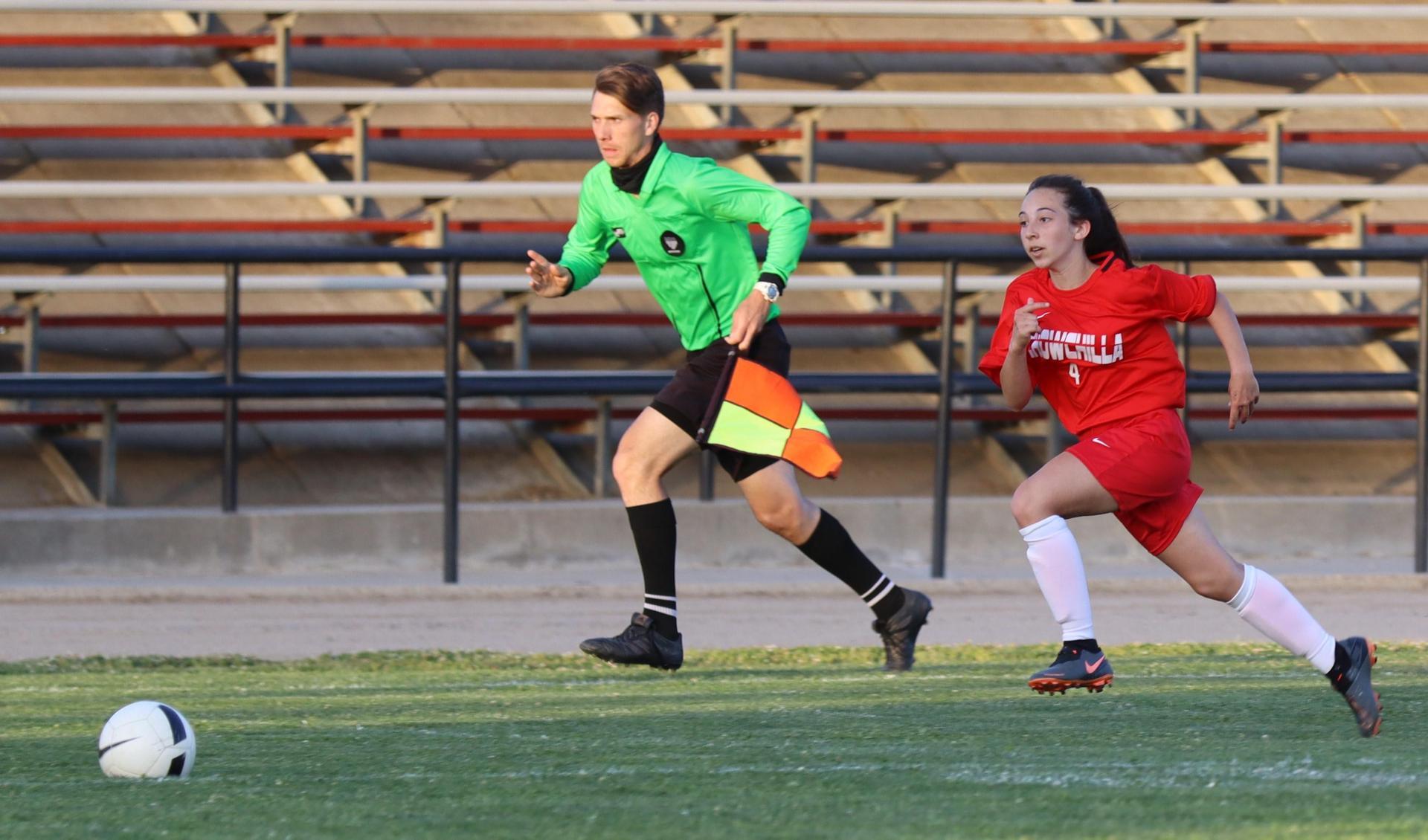 girls playing soccer against sierra
