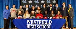 Photo of 16 WHS student-athletes who will compete at college level.  pictured with athletic director Sandra Mamary and WHS principal Mary Asfendis