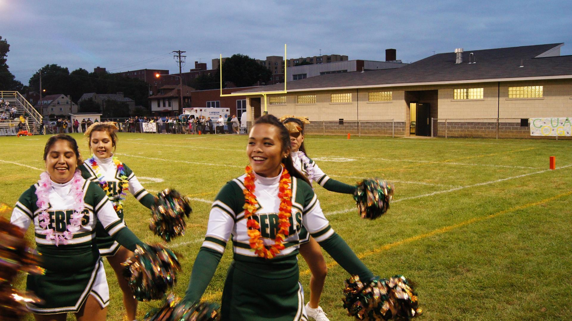 Cheerleaders at football game