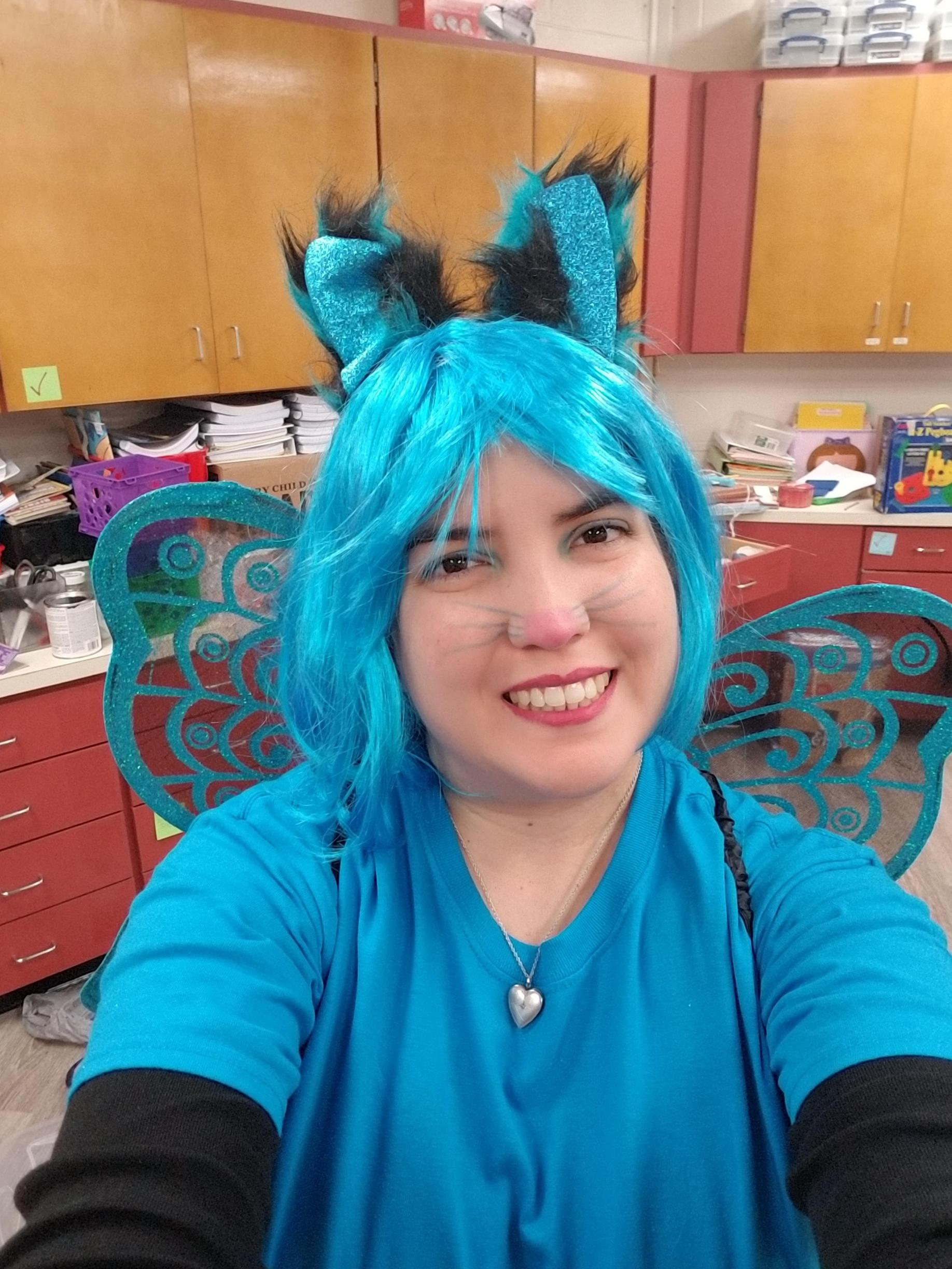 Mrs. Espinoza (Cat Fairy) is happy it's Friday as she has just completed her very first week of hosting a Scholastic Book Fair.