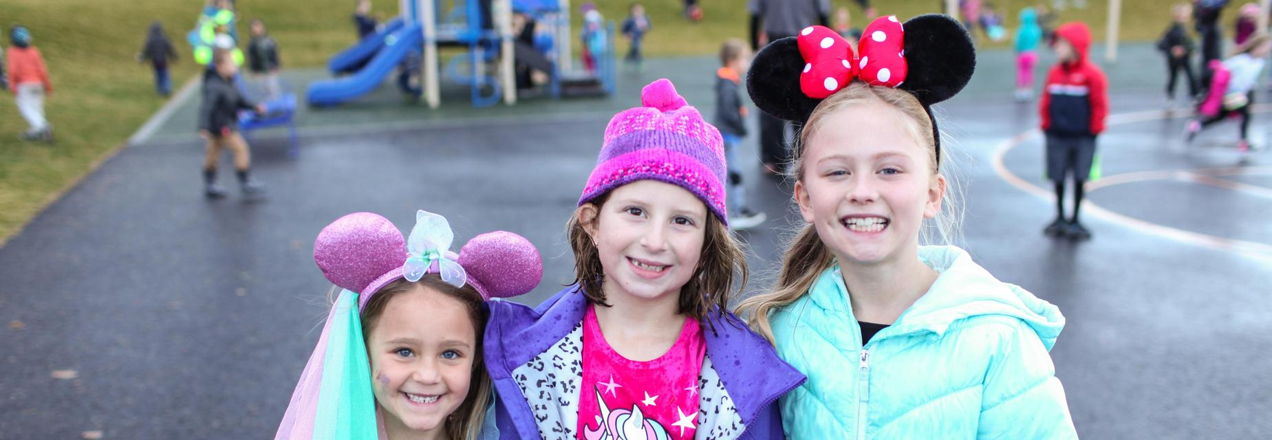 Hat day at Riverbend Elementary. Mickey mouse ears, pink hat, Minnie Mouse ears