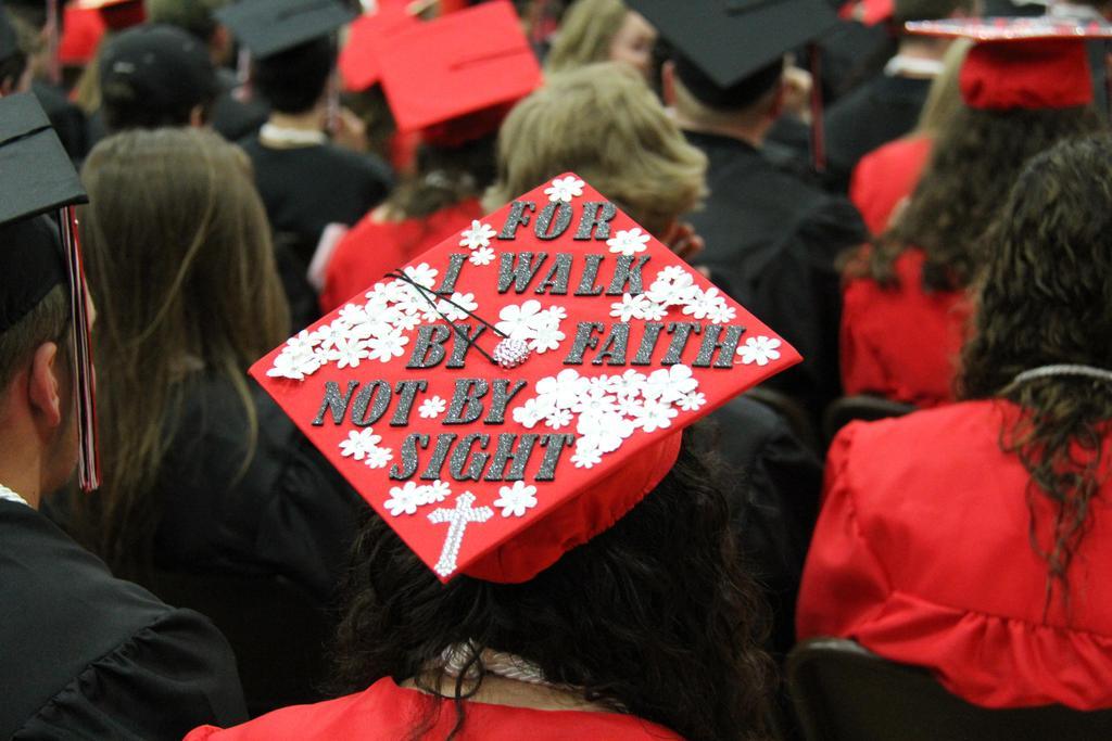 "Graduation cap that says, ""I walk by faith not sight""."