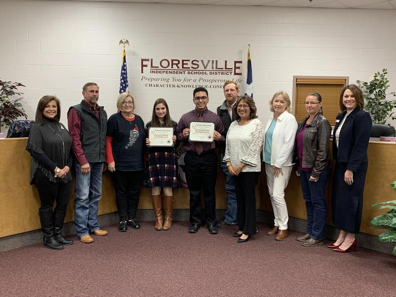 Administrators and Board Members standing with Students of the Month