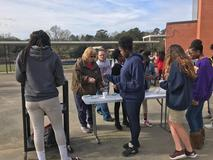 Mrs. Smith and Mrs. Storey handing out free hot chocolate