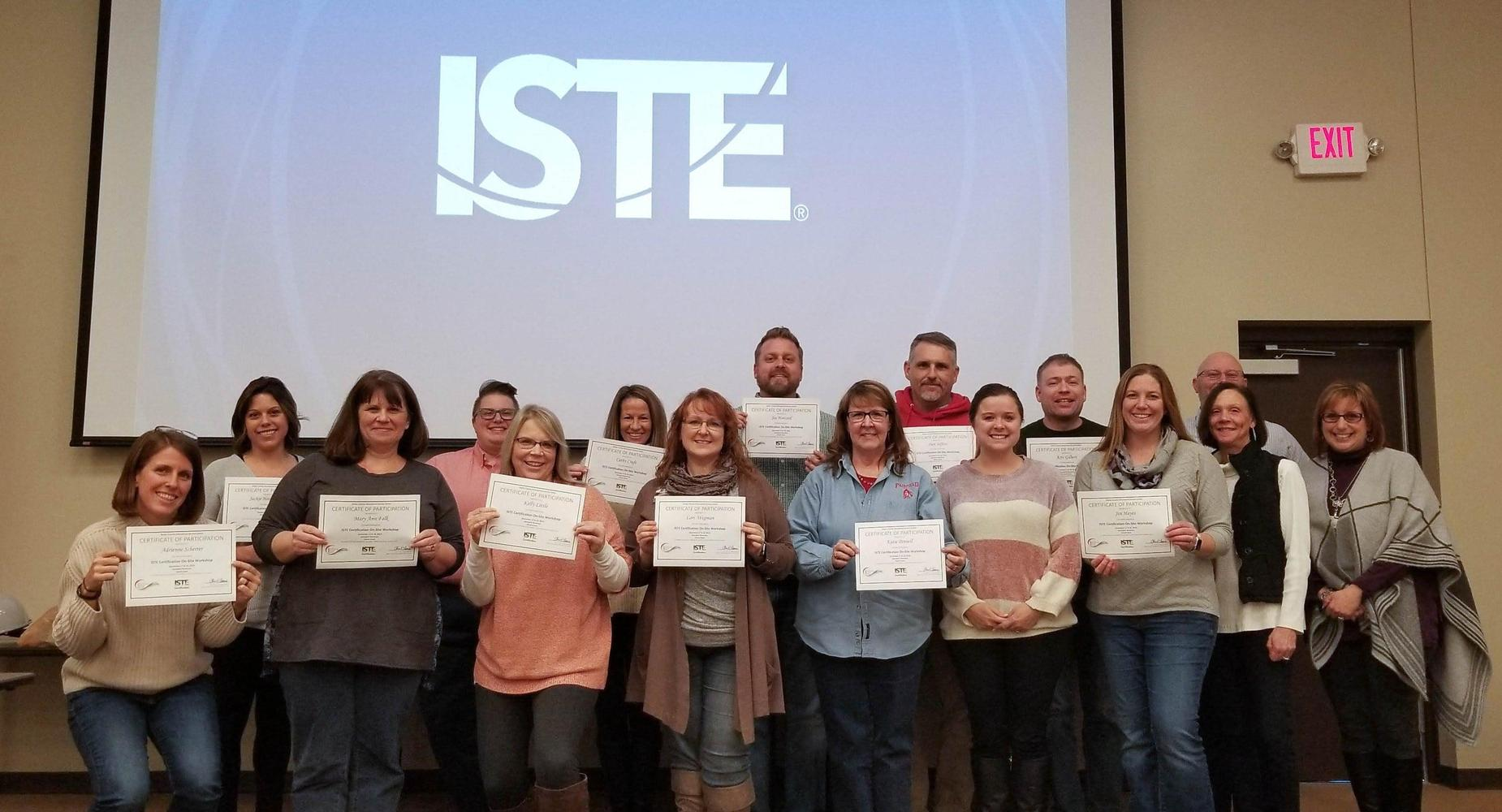 Educators stand and proudly display their ISTE Certification certificates at the conclusion of Butler County's first ISTE cohort