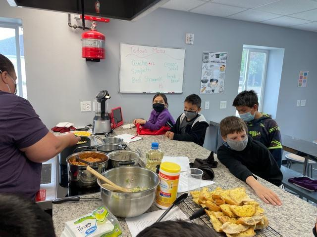 Sacajawea students learning about cooking