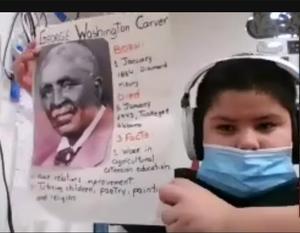 Boy holding up George Washington Carver project