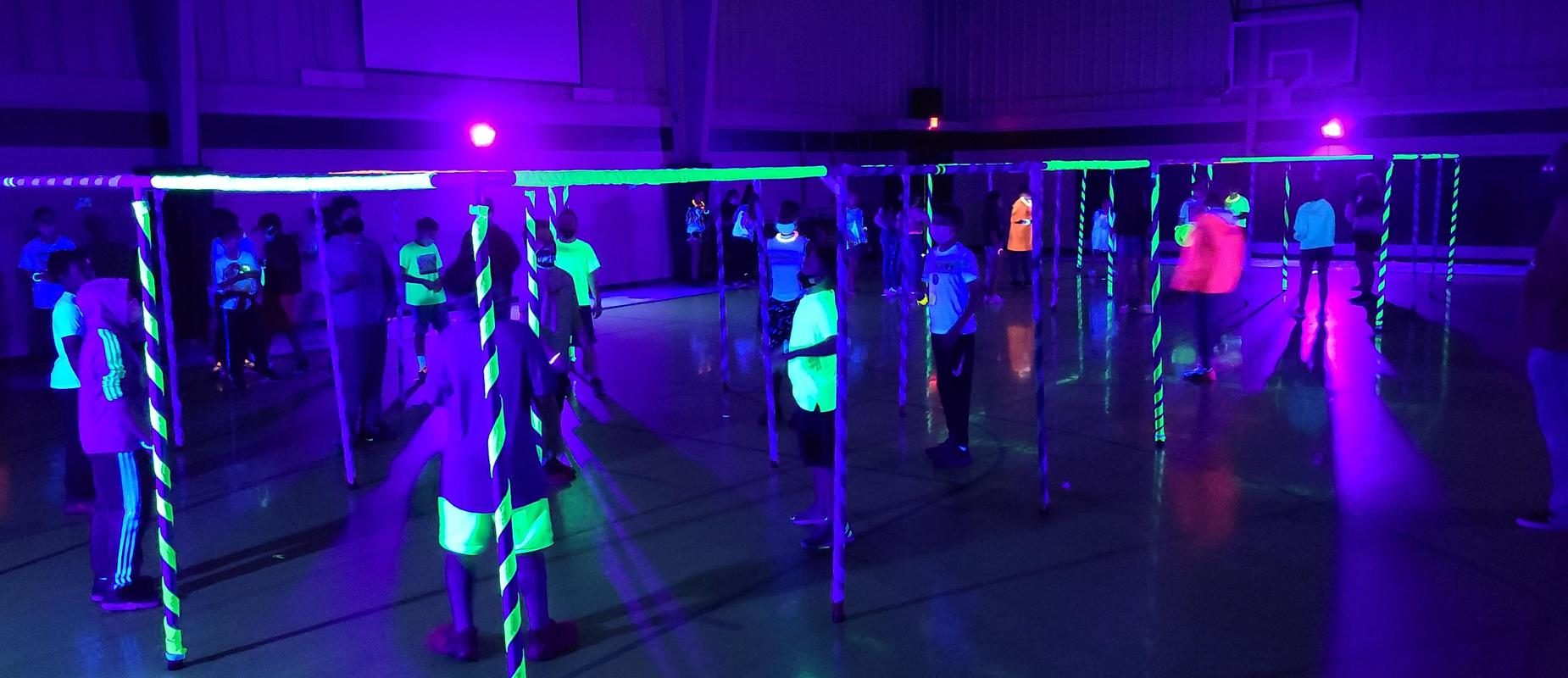 Glowing lights and poles with children