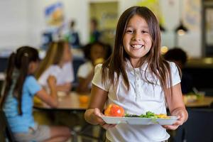 Girl holding a lunch tray