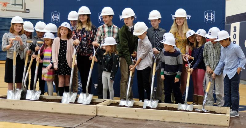 Photo of students shoveling dirt