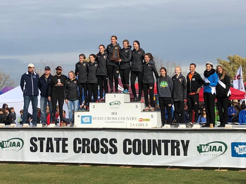Lady Eagle Cross Country Champions on the podium