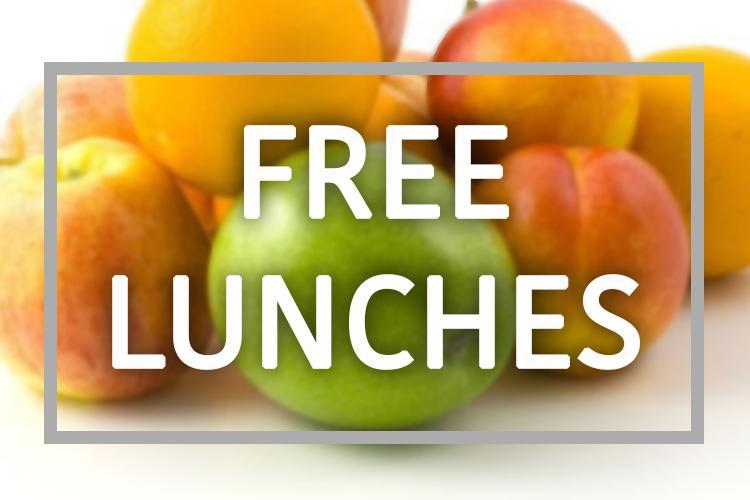 Picture of fruit with the words free lunch in front.
