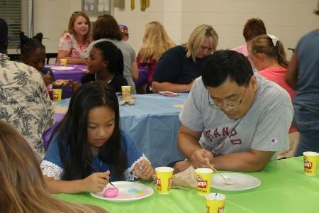 Parent and child painting rocks for Tifton Rocks.
