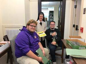 photo of OLSH students helping the Felician Sisters