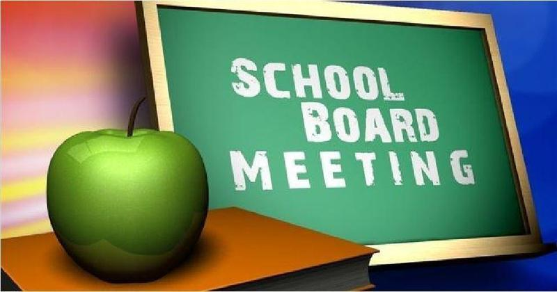 Chalkboard that says school board meeting